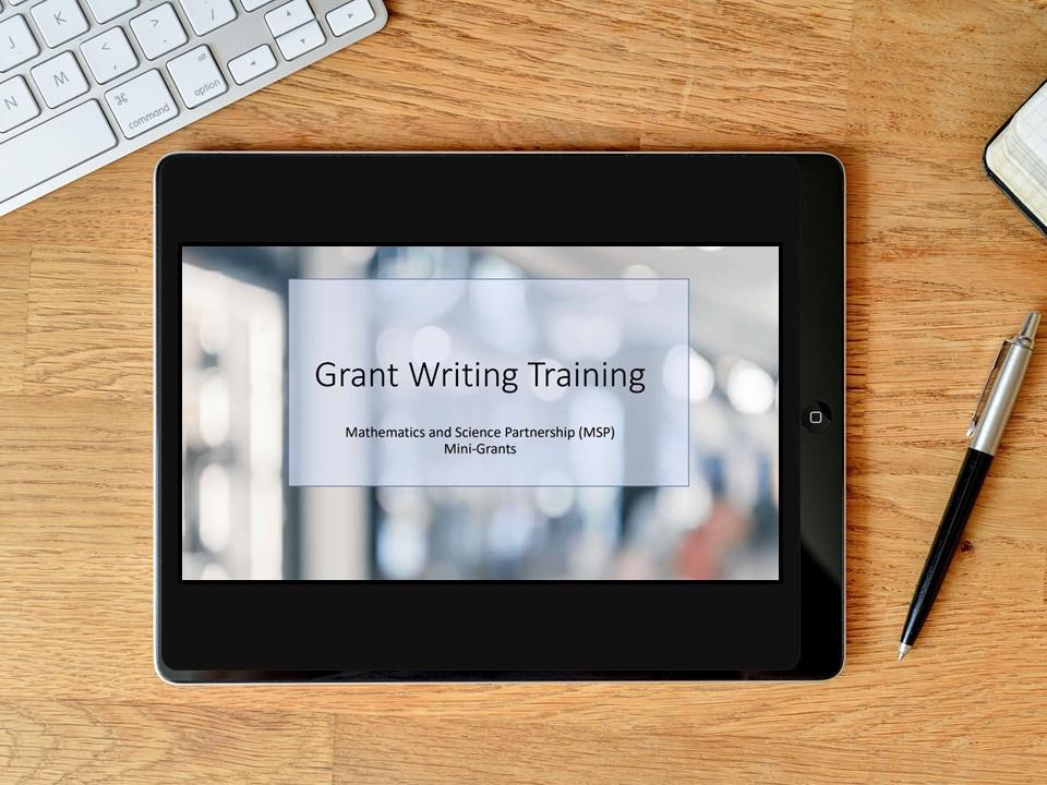 Start slide of vILT in tablet screen: Grant Writing Training